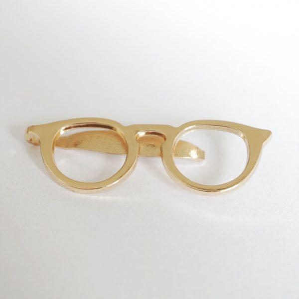 Zlatá spona na kravatu Okuliare